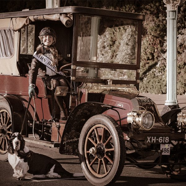 Victoria Melody and Major Tom in a vintage car