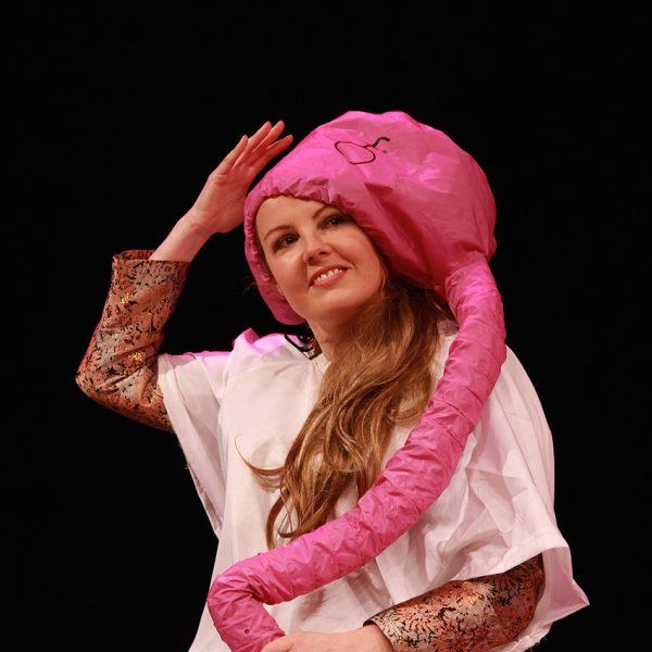 Victoria Melody performing in Hair Peace with a battery powered hairdryer