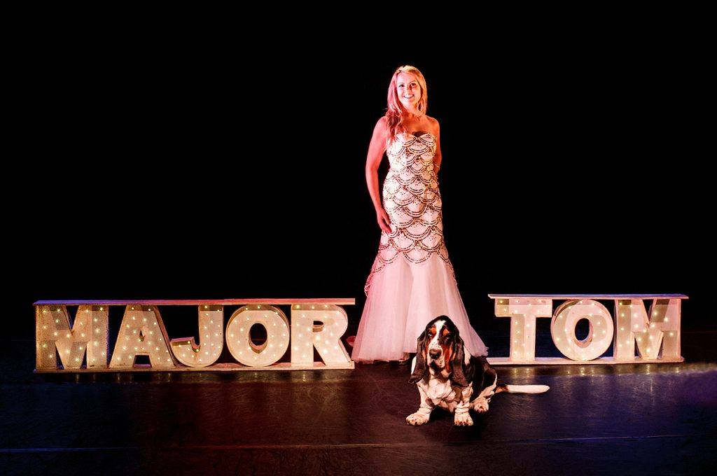 Victoria Melody on stage with her dog in Major Tom